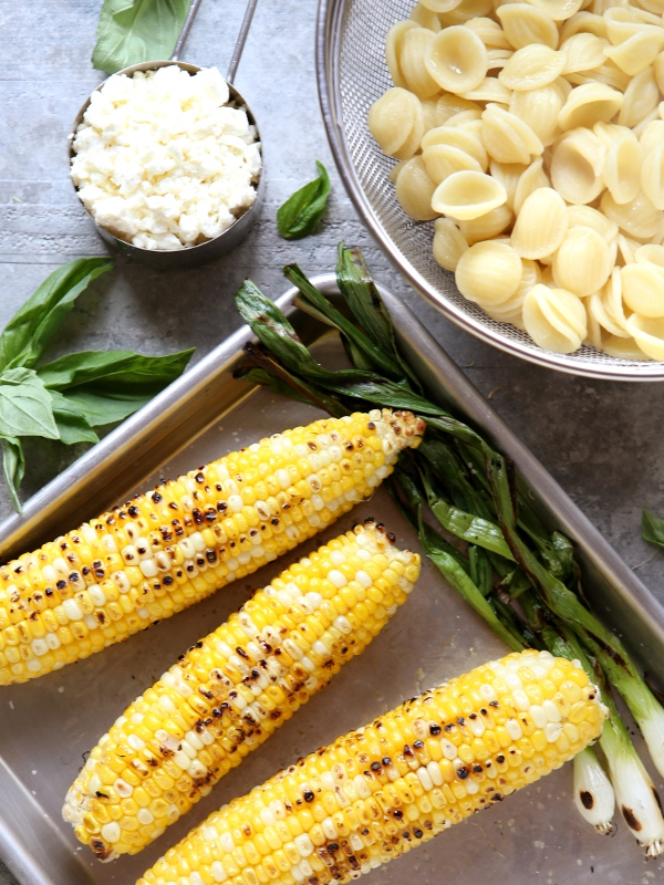Creamy Grilled Corn Pasta with Basil and Feta | completelydelicious.com