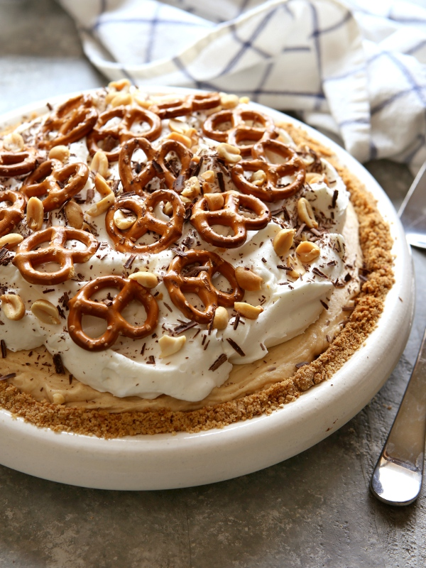 Peanut Butter Mousse Pie with Marshmallow Whipped Cream and Pretzel Crust | completelydelicious.com
