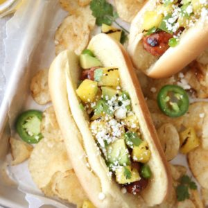 Hot Dogs with Pineapple Avocado Salsa | completelydelicious.com