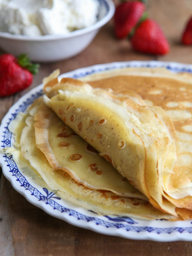 Homemade crepes to be served with strawberries and cream