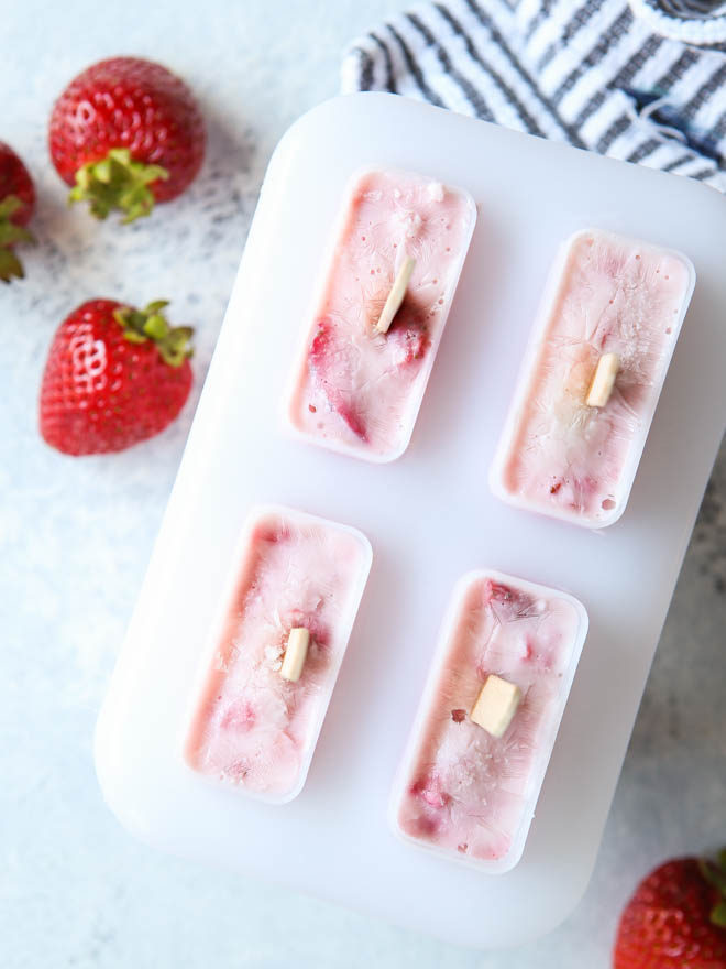 Roasted strawberry yogurt pops heading to the freezer