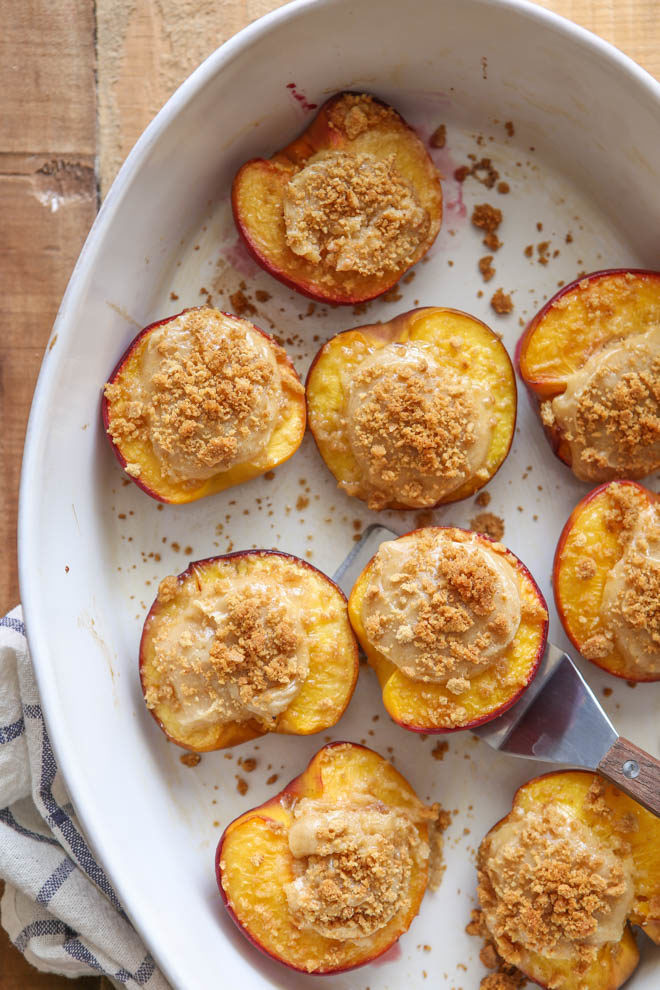 Cheesecake stuffed peaches with graham cracker topping is an easy summer treat!