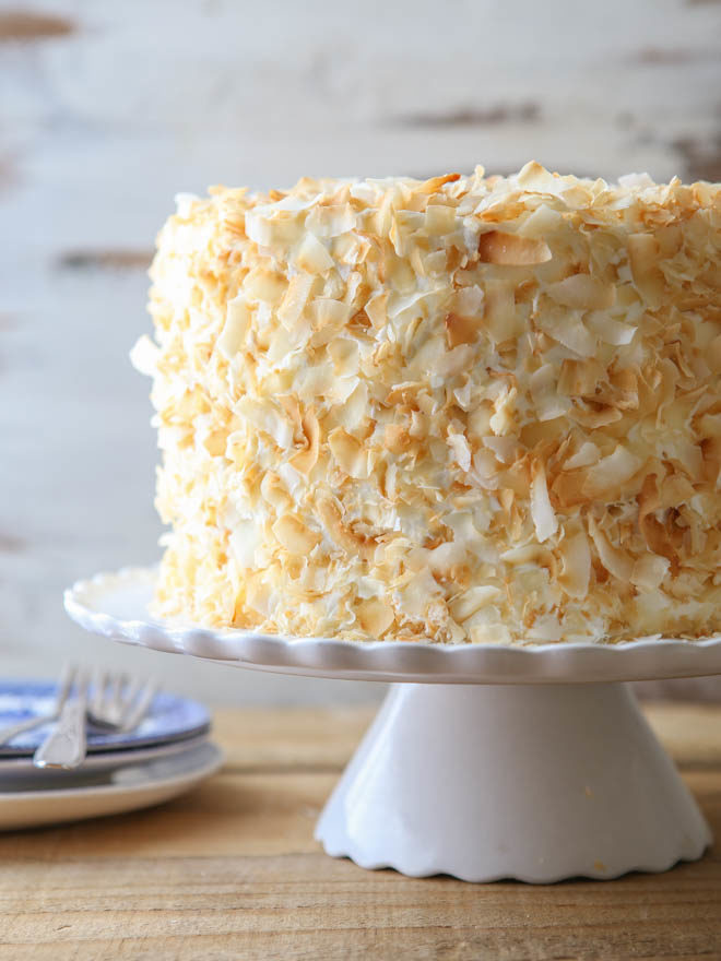This southern coconut layer cake has light and tender coconut cake layers, a creamy coconut filling, and coconut cream cheese frosting.