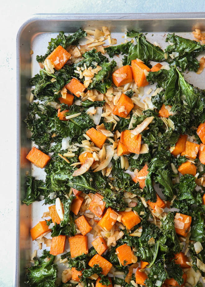 Roasted sweet potatoes and kale with shredded coconut and almonds