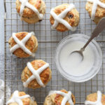 Pouring the glaze on these fun and flavorful hot cross biscuits