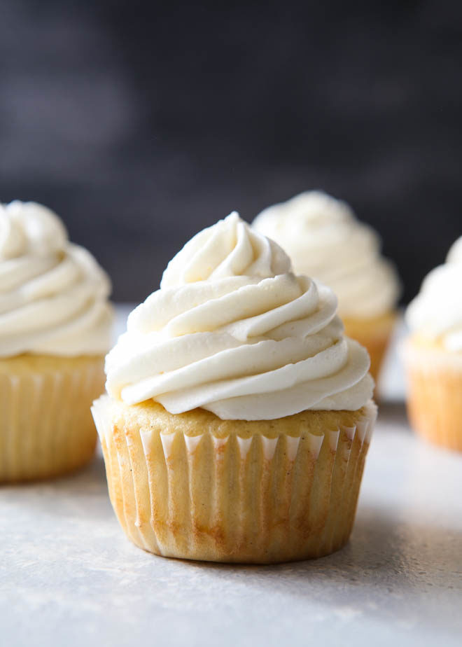 The fluffiest and creamiest vanilla frosting, piled on a cupcake