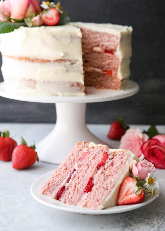 Homemade strawberry layer cake with fresh strawberries and cream cheese frosting