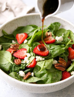 Strawberry spinach salad with warm brown butter dressing