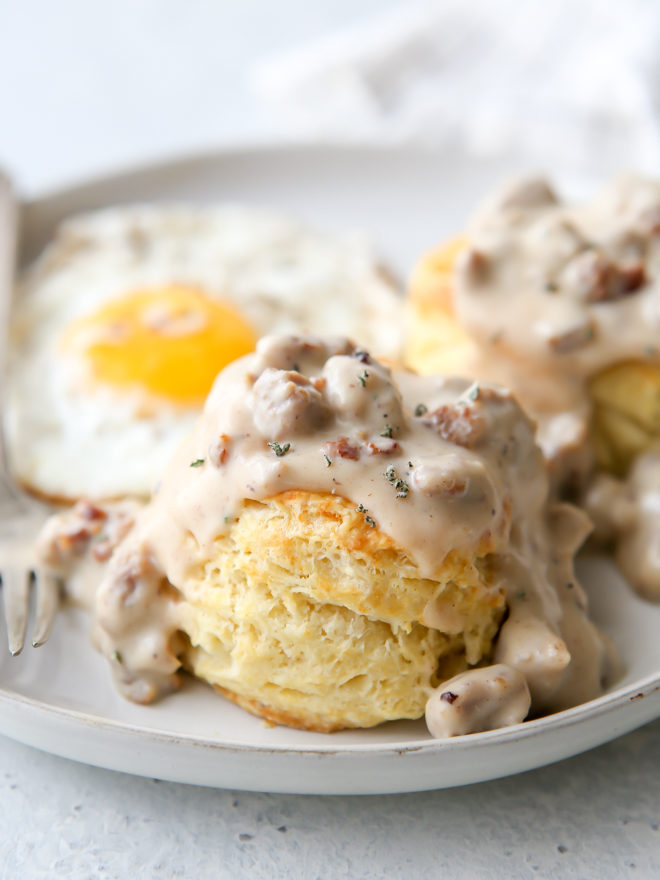Flaky buttermilk biscuits with homemade sausage gravy is a breakfast no one can resist!