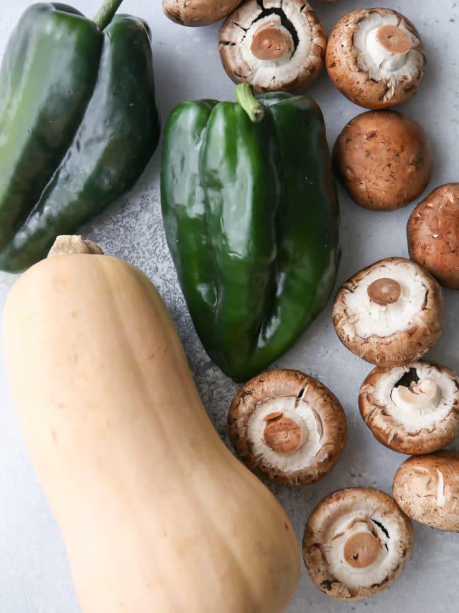 The making of butternut squash, mushroom and poblano enchiladas