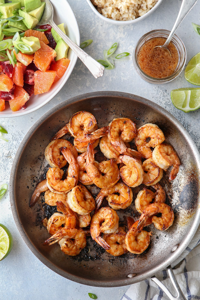 Making citrus shrimp bowls