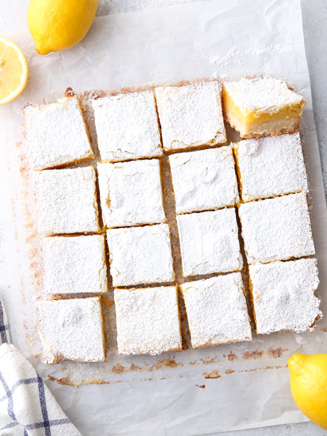 Classic lemon bars with a buttery shortbread crust, tart lemon filling, and powdered sugar topping are always a crowd favorite!