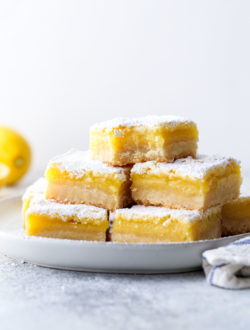 Classic lemon bars with a buttery shortbread crust, tart lemon filling, and powdered sugar topping is always a crowd favorite!