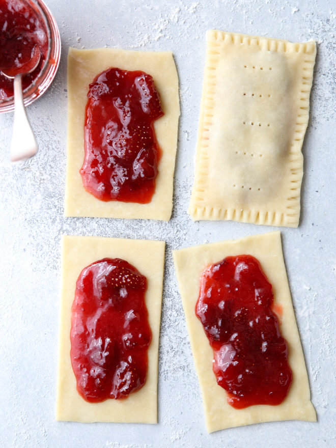 These homemade strawberry pop tarts made with strawberry preserves and flaky pastry are so much better than store-bought!