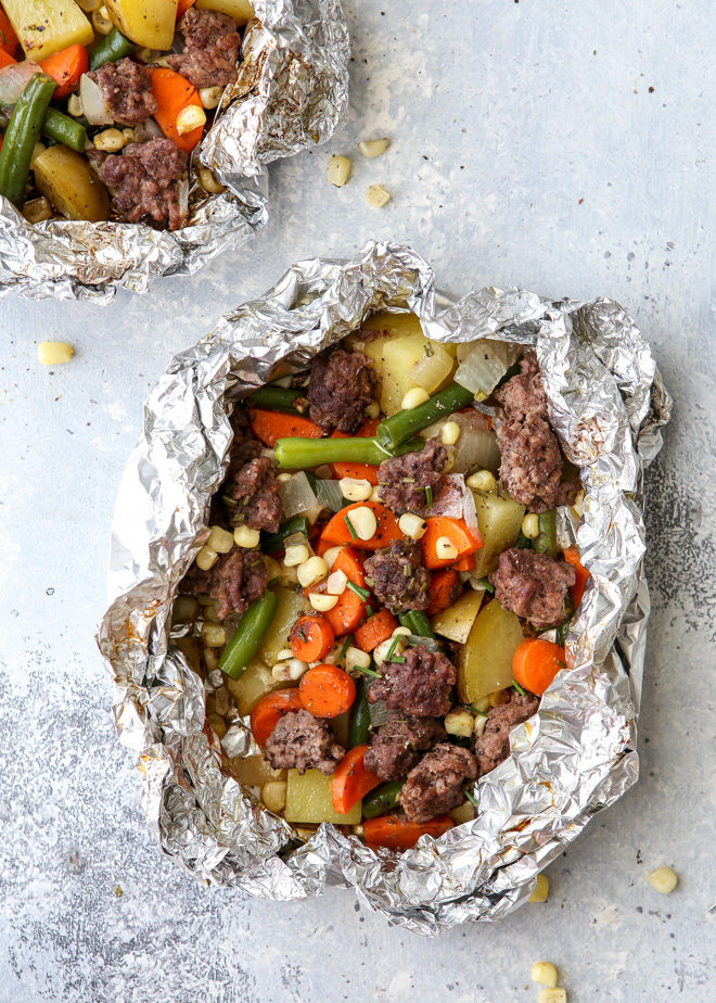 These beef and veggie tin foil dinners are an entire meal wrapped up in foil and cooked on the grill, over a fire, or in the oven.