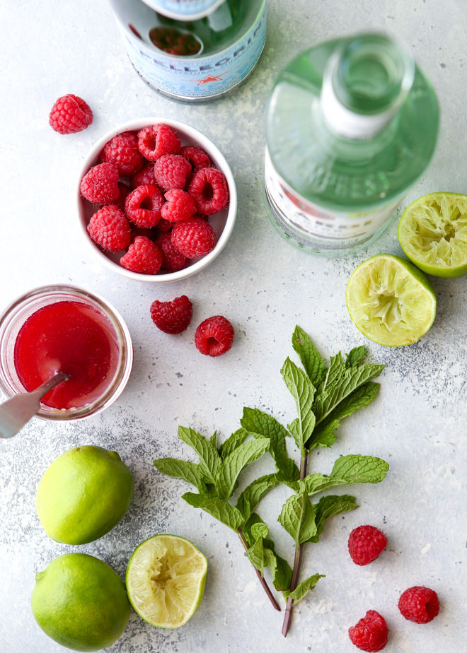 This refreshing raspberry mojito cocktail made with rum, mint, lime, and fresh raspberries is perfect for summer sipping!