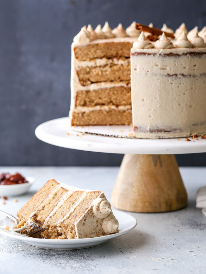 This brown sugar cinnamon layer cake is full of autumn flavor and spice, with moist cake layers and the fluffiest buttercream frosting!