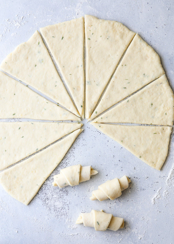 Rolling up garlic and herb crescent rolls