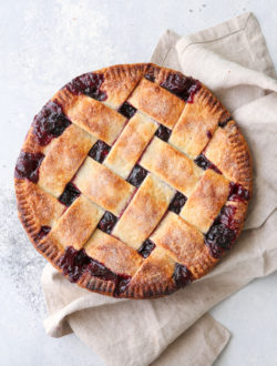 This cranberry blueberry pie is the perfect combination of sweet and tart, with plenty of cozy spices and a buttery flaky pie crust. It's perfect for the holidays!