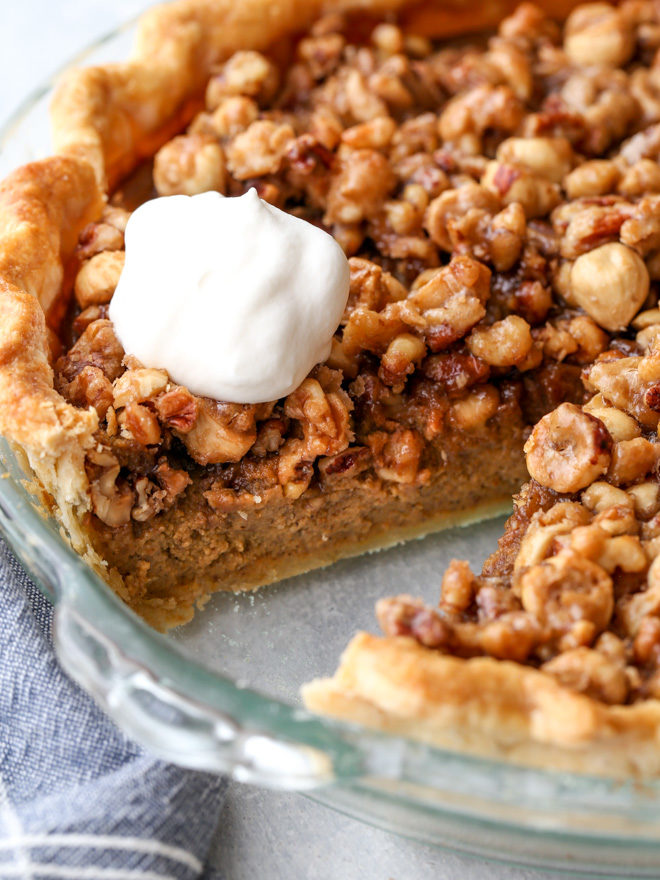 Pumpkin pie with nut praline is a delicious twist on the classic that's perfect for your holiday table!