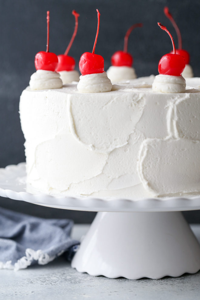 This cherry chip cake, smothered in a fluffy whipped vanilla buttercream, is a homemade version of a boxed cake mix favorite. It's also the perfect celebration cake!