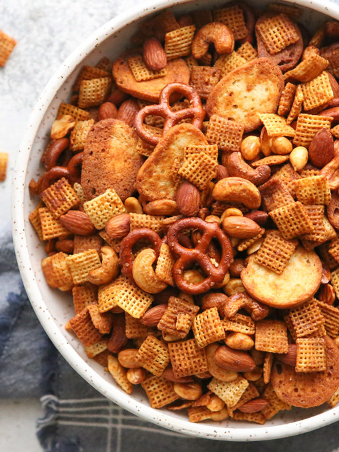 This snack mix filled with rice cereal, pretzels, and nuts is a little bit sweet and a little bit spicy.