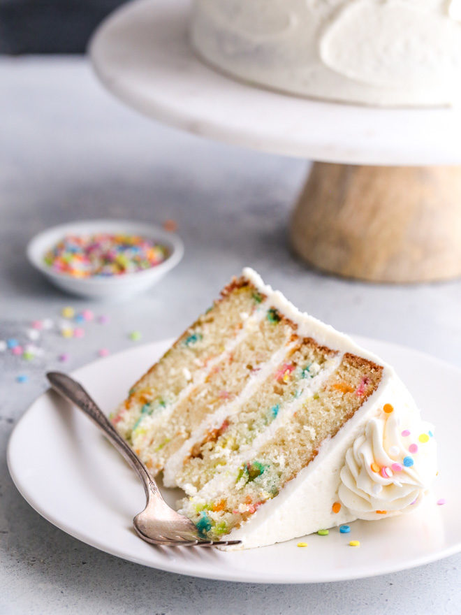 This funfetti cake made with light and buttery vanilla cake layers studded with rainbow sprinkles and fluffy vanilla buttercream frosting is such a fun and cheerful dessert!