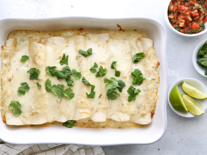 These sour cream chicken enchiladas are a family favorite! They're cheesy, creamy, and made completely from-scratch!