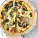 A breakfast bake filled with roasted broccoli, bacon, Gruyere cheese, eggs and chives. It's a quiche minus the fussy pie crust!