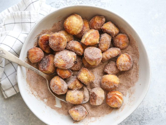 Coat pretzel bites with butter and cinnamo-sugar
