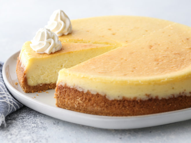 Classic cheesecake with graham cracker crust is silky smooth, ultra rich, and very creamy.