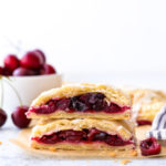 cherry hand pies cut in half and stacked