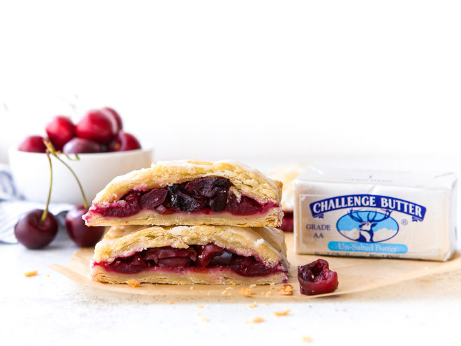 cherry hand pies cut in half and stacked with Challenge Butter