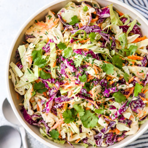 This is the easiest classic coleslaw filled with cabbage, carrots, chives, cilantro and a creamy mayo dressing.