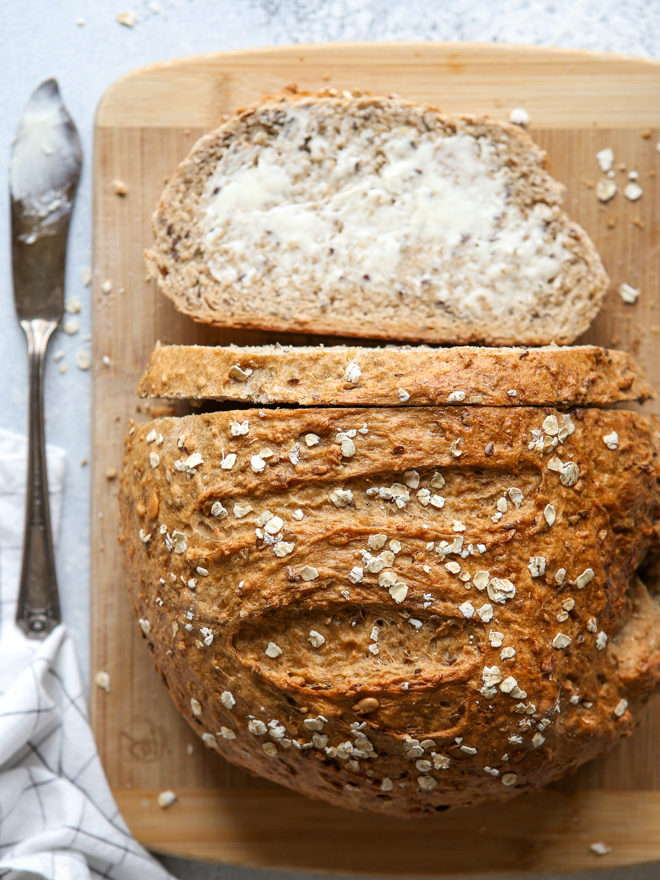 rustic multigrain bread, sliced with butter