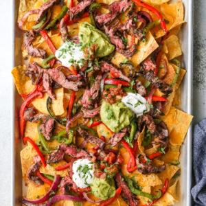 steak fajita nachos on sheet pan