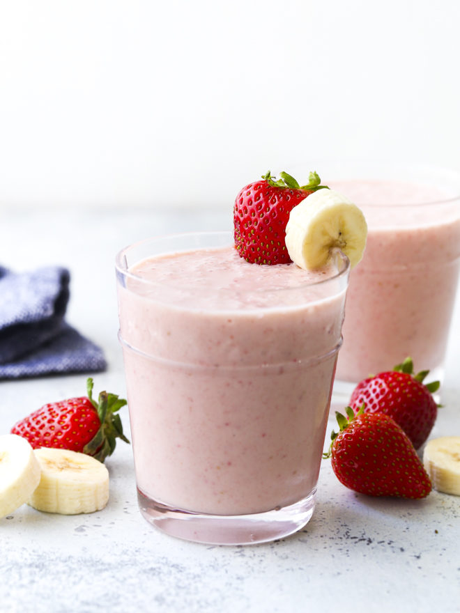 strawberry banana smoothie in cup with fruit