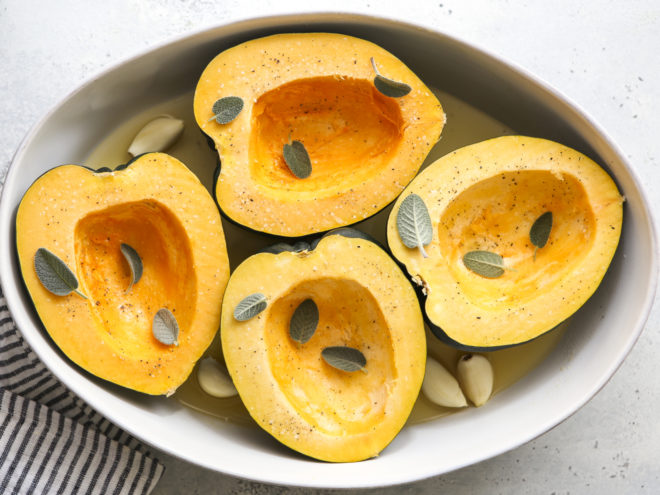 acorn squash in dish ready for roasting