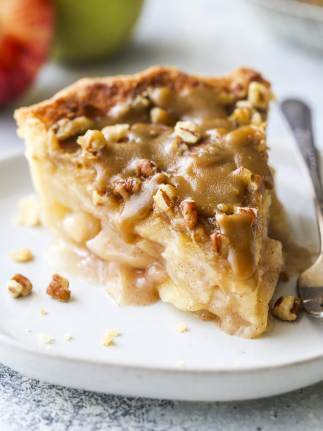 closeup of apple pear praline pie slice on plate