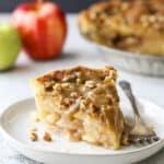 apple pear praline pie slice on plate