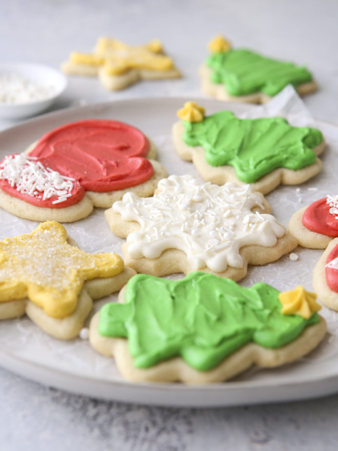 side angle of frosted sugar cookie cut outs on a plate