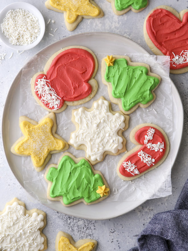 frosted sugar cookie cut outs on a plate