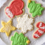 closeup of frosted sugar cookies on a plate