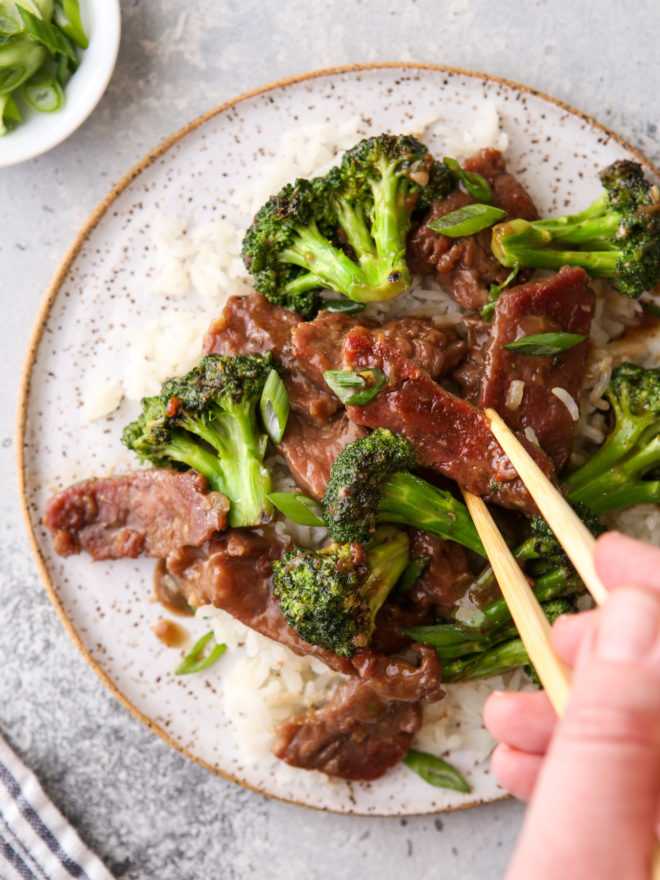 stir fry beef with broccoli and chopstick