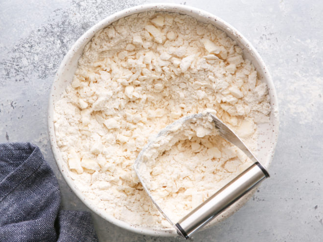 cutting butter into flour for puff pastry