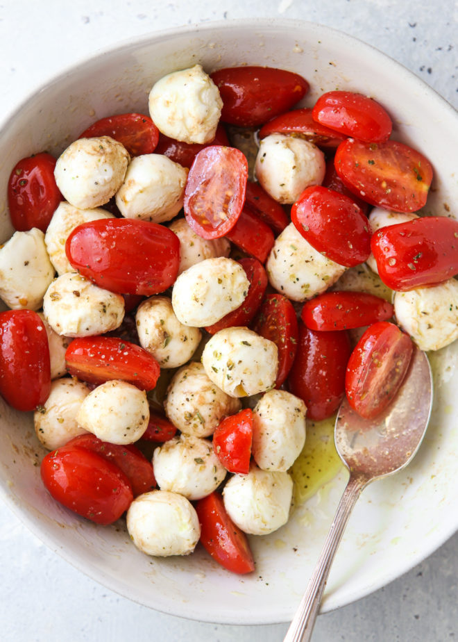 marinated tomatoes and mozzarella in olive oil and herbs