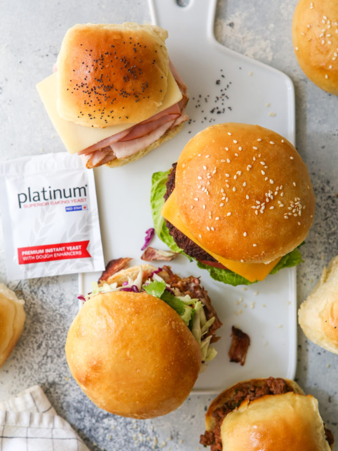 sandwiches, sliders and burgers on different buns with Red Star Yeast envelope