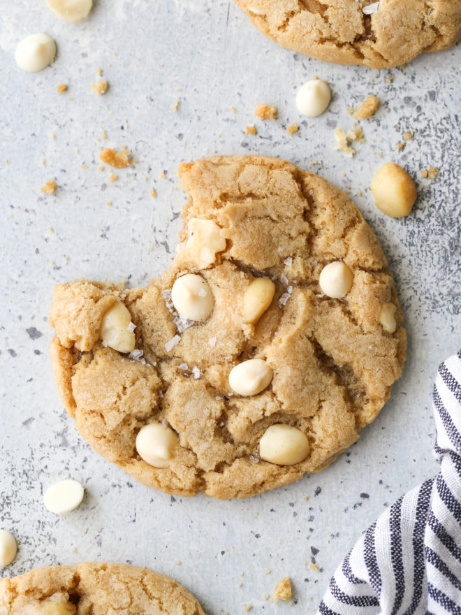 a white chocolate macadamia nut cookie with bite taken out