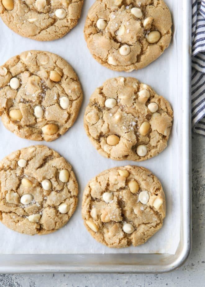 baked white chocolate macadamia nut cookies on a sheet pan
