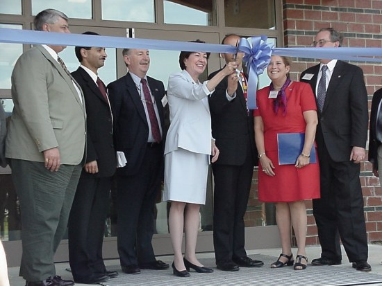 Photo of ribbon cutting ceremony during the center's grand opening in 2000.